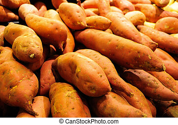 pile of sweet potatoes in bin,isolated