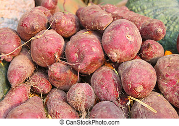 Pile of sweet potatoes at vegetables market