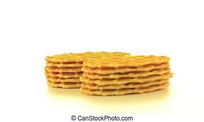 Pile of sweet waffles rotating on white background.
