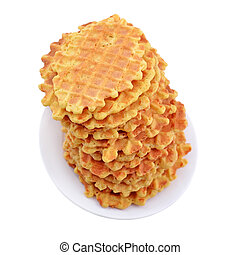 Pile of sweet waffles on a plate.