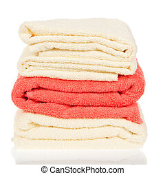 Pile of the bathing towels, isolated on white