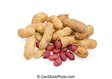Pile of the partly peeled roasted peanuts on white background