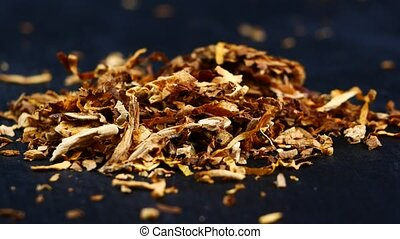 Pile of tobacco on a black background