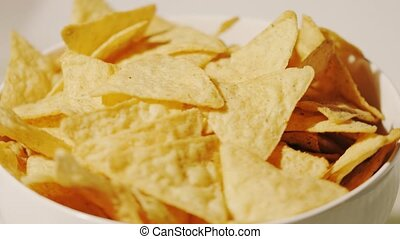Pile of tortilla chips on the plate, close-up shot