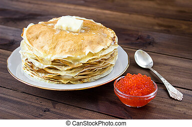 Pile of traditional russian Pancakes on plate with red caviar