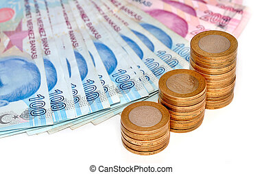 Turkish paper money and coins tower on white background