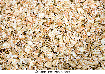 oats - Pile of uncooked rolled oats - oatmeal background