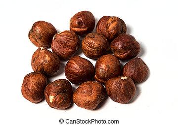 Pile of unshelled hazelnuts isolated on white background