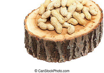 Pile of unshelled peanuts, isolated on white background