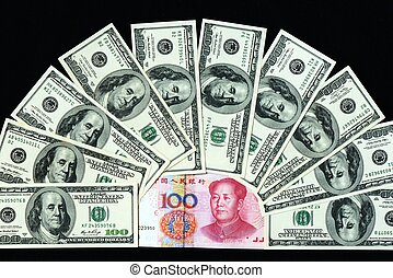 USD and RMB bank notes - Pile of USD and RMB bank notes on a...