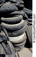 Pile of used old rubber tire