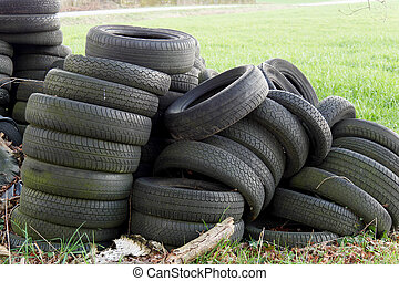 Pile of used tires in countryside