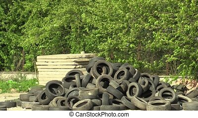 Pile of used tires rubber in a waste collection yard, ready...