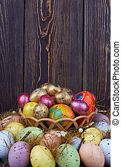 Pile of various easter eggs and copy space.