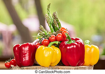 Pile of vegetables on wooden surface.