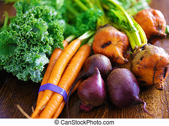 pile of veggies with carrots, beets and kale
