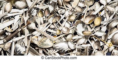 Pile of vintage silverware, spoons metal background