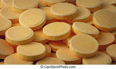 Pile Of Vitamin C Tablets Rotating - Pile of vitamin C pills...