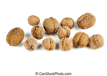 Pile of walnuts isolated on white background.
