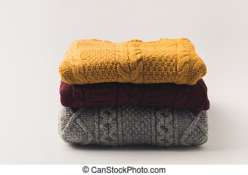 sweaters - pile of warm cozy sweaters,  isolated on white