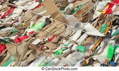 Pile of waste carton for recycling, closeup view in motion
