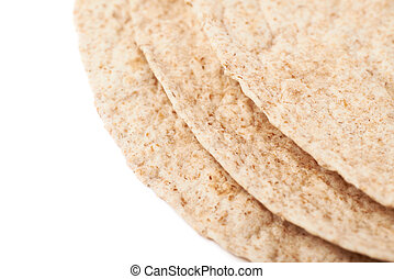 Pile of wheat tortillas isolated