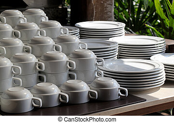 pile of  white ceramic cup and plate