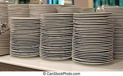 pile of  white ceramic plate