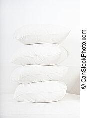 pillows - pile of white pillows on sofa