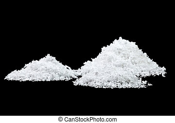Pile of white snow isolated on black background