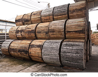 Pile of wooden electric wire reels tilted out
