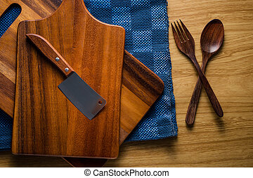 pile of wooden kitchen utensils