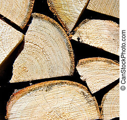 Pile of wooden logs stacked for firewood