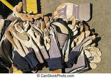 Pile of Work Gloves - Leather work gloves left in a large...