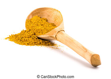 yellow turmeric on wooden spoon - pile of yellow turmeric on...