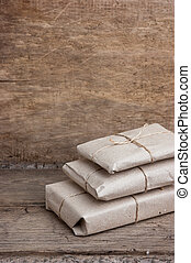 pile parcel wrapped with brown kraft paper and tied with ...
