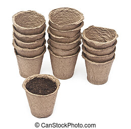 pile peat pots for growing seedlings, isolated on white ...