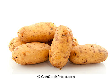 potatoes - pile with raw potatoes isolated over white