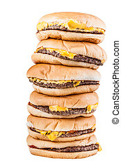 Piled burgers - a very tall pile of cheesburgers isolated...