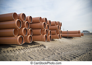 piled up pvc pipes