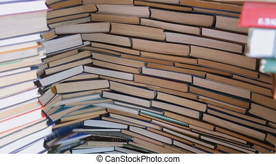 Piles of Books Beautifully Stacked in a Row