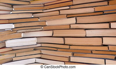 Piles of Books Beautifully Stacked in a Row. Background from...