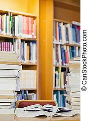 Piles of books on desk