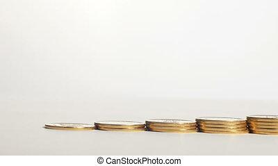 Piles of coins grow