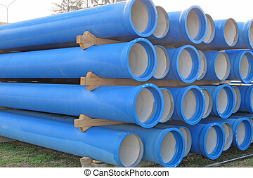 piles of concrete pipes for transporting sewerage