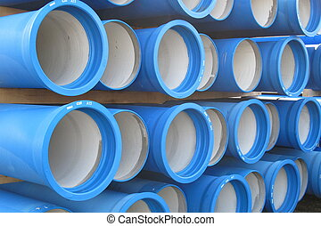 piles of concrete pipes for transporting water and sewerage...