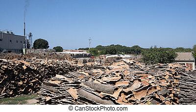 Piles of Cork Oak bark left to dry, Sardinia, Italy, Europe
