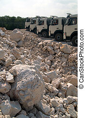 piles of gravel and trucks