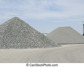 Piles of gravel - Two big piles of gravel at industrial site