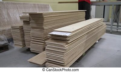 Piles of laminated floor panels in the workshop interior....